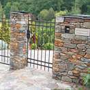 Stone fence with wrought iron